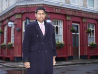 Annesley outside the 'Queen Vic' pub in Albert Square on a visit to the EastEnders set in January 2009