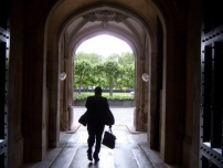 Annesley walking through an archway on the Parliamentary Estate