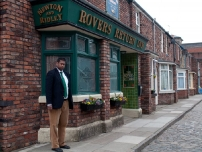 Annesley Abercorn outside the 'Rovers Return' pub on Coronation Street - ITV Granada Studios, Manchester.