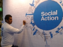 Annesley pledging his support for the Party\'s efforts for Social Action by signing the wall at the Conservative Party Conference 2011