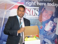 Annesley packing food parcels for our troops at the Conservative Party Conference 2012.