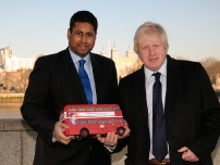 Annesley with Mayor Boris Johnson holding a model version of the battle bus