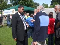 Annesley talking to a local resident at the carnival about local issues
