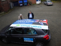 A couple of hardworking activists try to work out how to transport Annesley's large 8 x 4 election posters