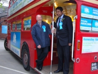 Annesley with a hardworking activist and the battle bus