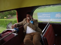 Annesley on the megaphone whilst travelling on the battle bus