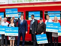 David Cameron, Annesley and activists outside the bus (close-up)