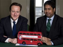 Annesley with David Cameron in his private office and a model version of his battle bus