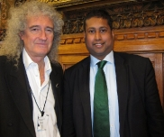 Annesley with rock star, Brian May.